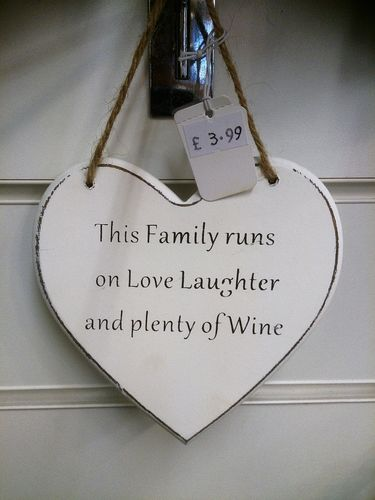 This Family runs on Love, Laughter and plenty of Wine Wall Plaque